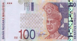 Malaysian ringgit falls, PM raises taxes on rich