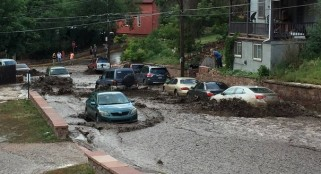 Colorado Springs flash flooding as heavy rains open sinkholes and wash away cars